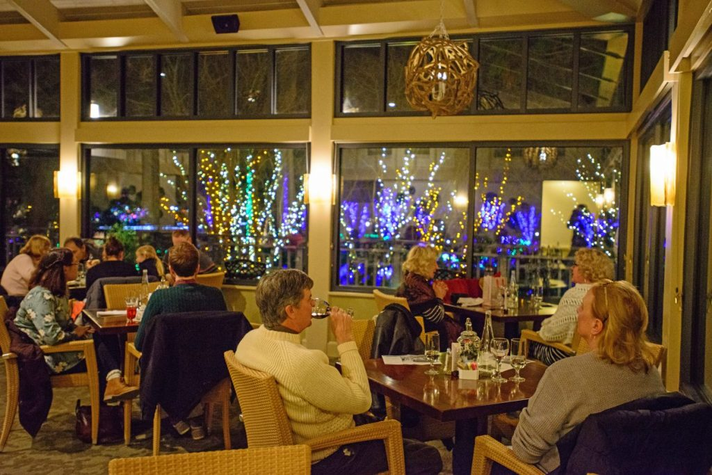 Dining in the Robins Tea House at Dominion Energy GardenFest of Lights during the holidays. Image by Garrett Nasrallah