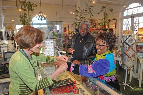 Buying jewelry in the Garden Shop, photo by Scott Elmquist