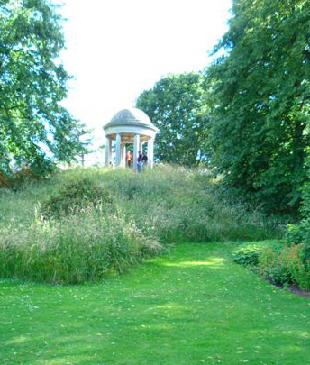 Partially unmown hillside at the world-famous Royal Botanical Garden, Kew, in England