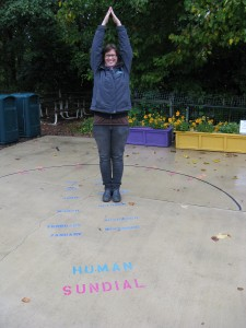 Krissi tries out the Human Sundial she created