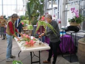 Helen Pinckney and Bocky Talbott crafting orchid arrangements.