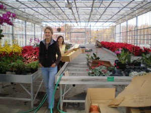 Abbie Wharton & Peyton Wells fetching more orchids from the greenhouse for the floral design team.