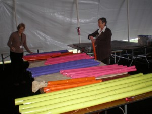 Former board member Susan Armstrong and volunteer Rene Henderson prepare handmade bamboo chandeliers for the gala.