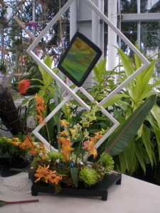 One of the orchid sculpture arrangements that will be available for auction at Splendor Under Glass.