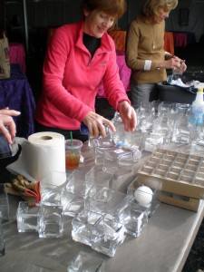Peggy Guy & Douglas Martin prepping candle-holders for the tables.
