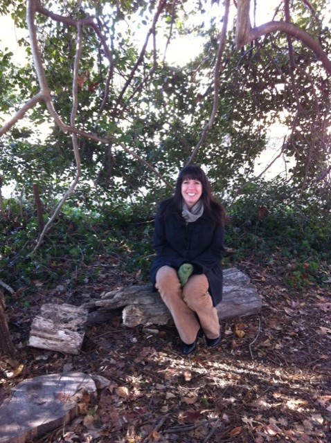 Kristin Mullen sitting inside the Holly Tree in the Children's Garden