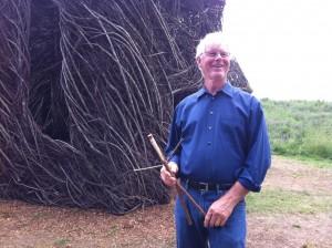 "Sculptor Patrick Dougherty with a keepsake ""Stickman"""