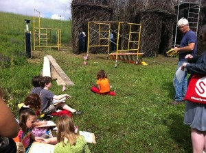 Sabot Kids with talking to Patrick Dougherty -- while they sketch the stick sculpture