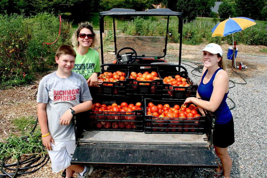 Left to right: Matthew, Christine & Leigh still look fresh and chipper after harvesting 500 pounds of fresh produce for FeedMore's Community Kitchen.
