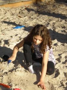 Girl playing in sandbox at Lewis Ginter Botanical Garden