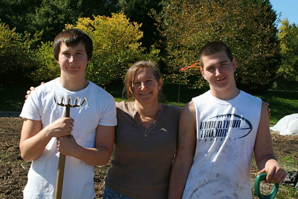 Left to right: Josh, April (mom) and Masen on a balmy day in the garden three weeks ago.