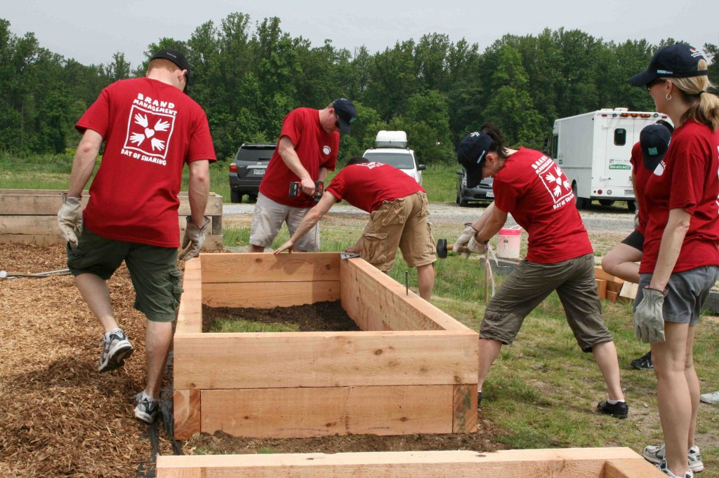 The Altria team literally leaps into action constructing raised bedsfor the wheelchair accessible portion of the garden.