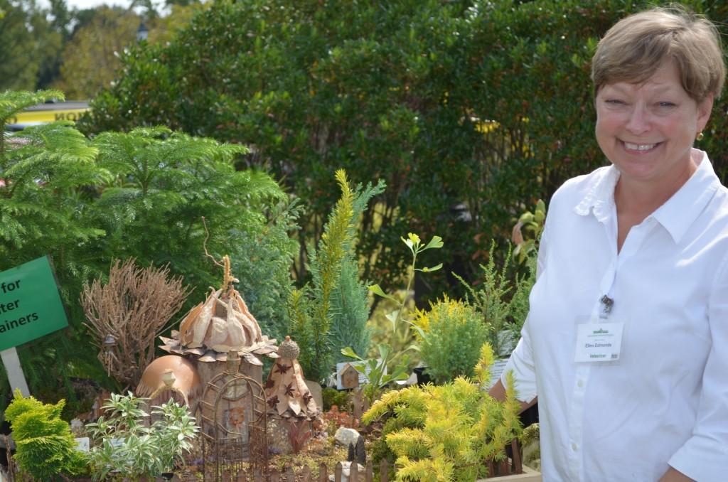 Volunteer Ellen Edmonds, and the Fairy House demonstration garden with miniature plants & trees