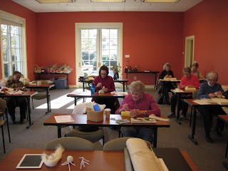 Class participants working with felt.