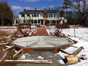 DURING Construction: The new concrete pad that will form the base for the new summer house in front of Bloemendaal House in the Grace Arents Garden.