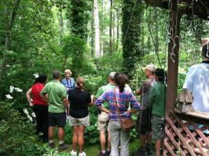 Norie Burnet explains maintenance tasks in a moss garden with LGBG horticulture staff.