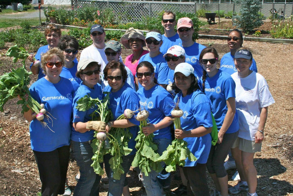 With good humor unsuppressed after 3.5 hours of heavy gardening labor, 17 of the 22 Genworth volunteers display some of the results of their labor. The Genworth team was led by Jen Phillips (front row, second from right).