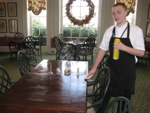 Kyle Joseph cleaning tables in the Garden Cafe.