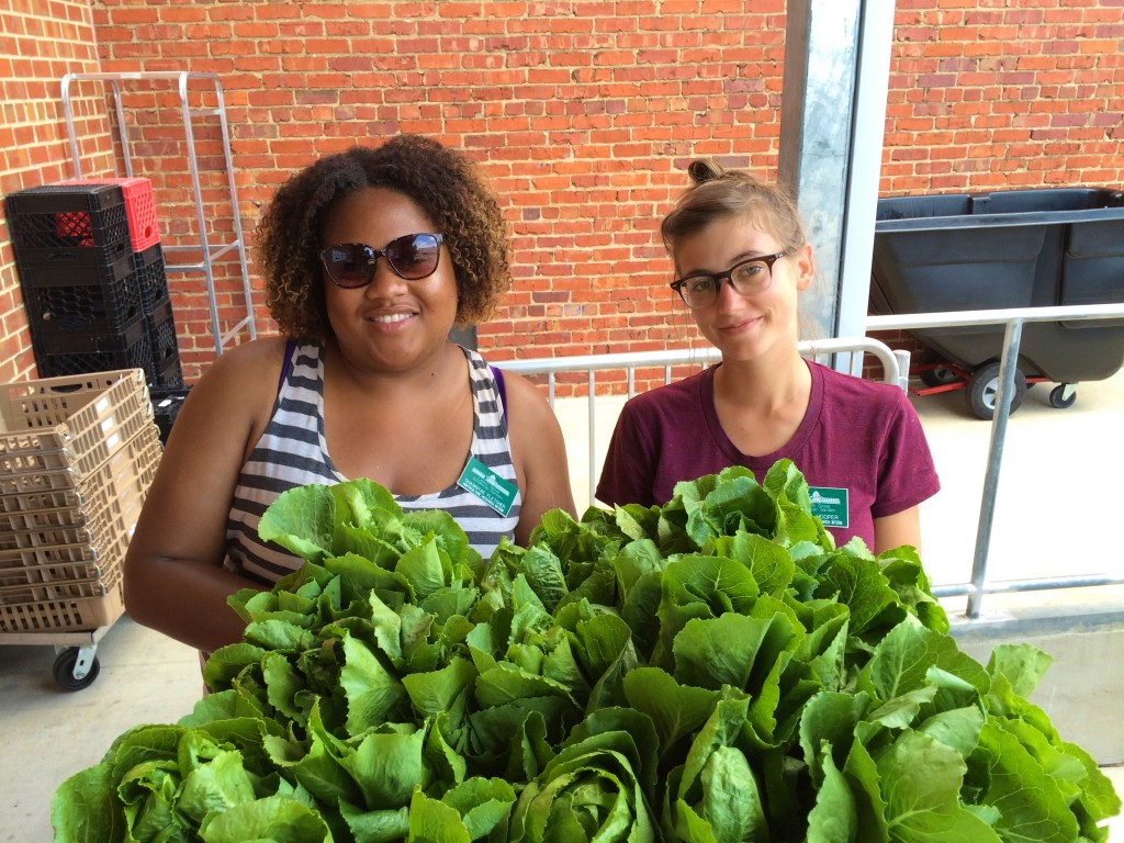 Lewis Ginter Horticulture interns Shawntae Fletcher (left) and Holly Hooper deliver the last of the Spring lettuce to FeedMore's Community Kitchen.