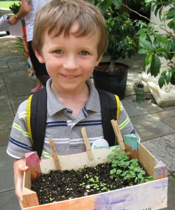 child with crate garden
