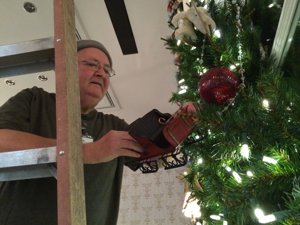 volunteer Gary McNutt taking down Dominion GardenFest of Lights decorations.