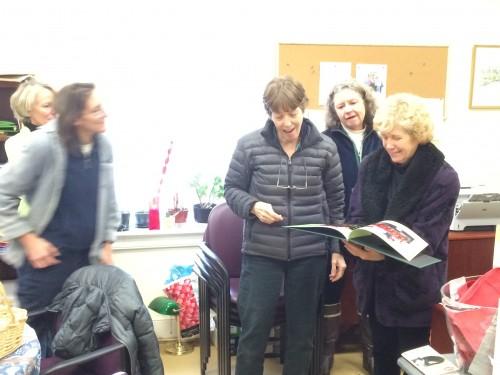 Volunteers looking at gift book