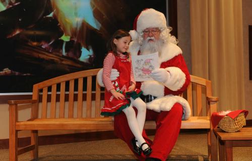 Santa with child at Santa Brunch