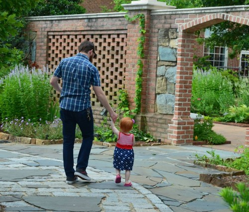 Dad and Child exploring Lewis Ginter Botanical Garden during a free admission day.