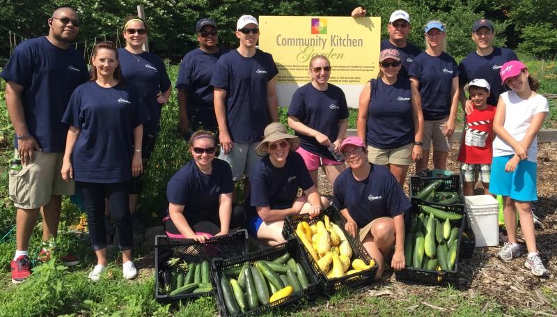 ChemTreat staff volunteering on the Community Kitchen Garden  with their harvest.
