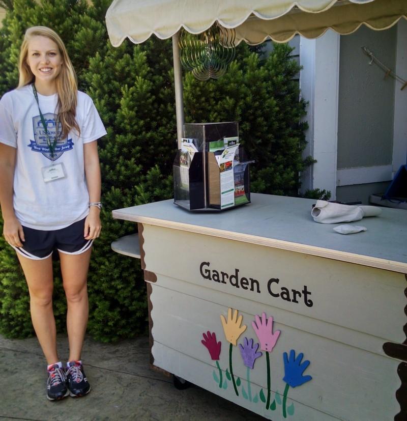 Collegiate student Allie Diemer on her first day volunteering at the Garden for her senior project.