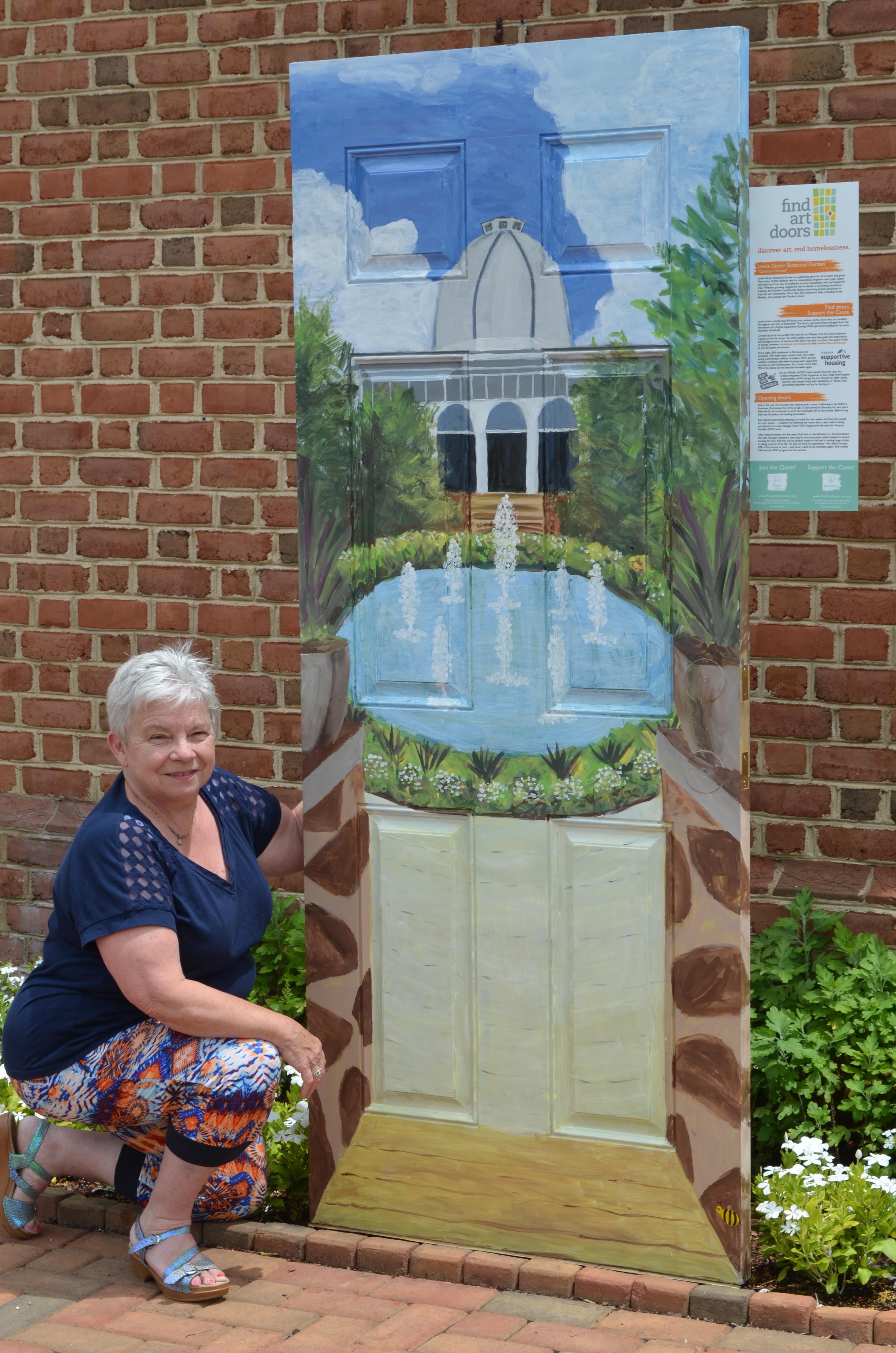 Garden volunteer Karen Beasley with her Art Door.