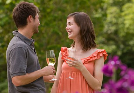 Young couple drinking wine in the Garden at Flowers After 5 Concerts