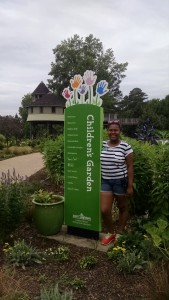 Henrico High School IB student Lia Bazemore in the Children's Garden. Bazemore is here as an intern with Partnership For the Future.