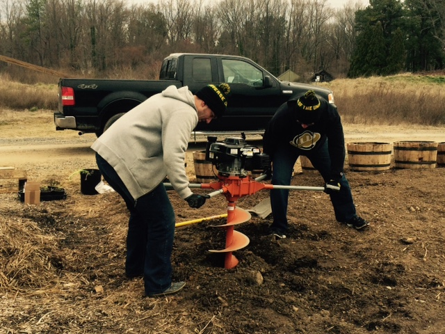 COTU founders, Chris and Phillip Ray,  use an auger to make the hole for the 4x4 posts.