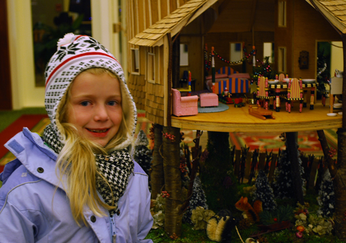 Girl looking at Doll House. photo by Patricia Cancro
