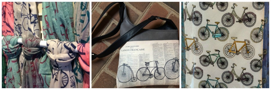 Scarves, neck ties and a tote bag all decorated with bike motifs.