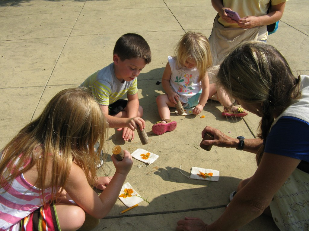 The youngest visitors are some of our most enthusiastic artists when pounding petals is involved!