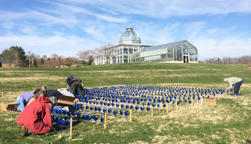 placing pinwheels in the pinwheel garden for pinwheels for prevention - Lewis Ginter Botanical Garden