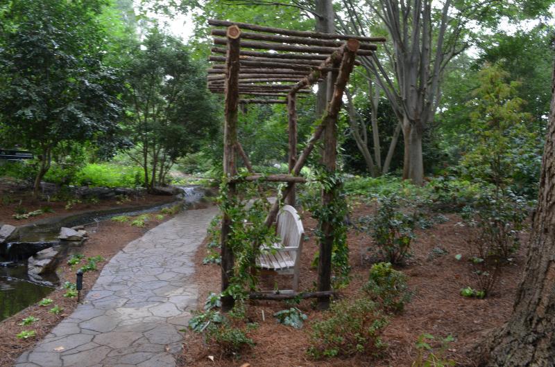 The wooden bench in Dots Garden.