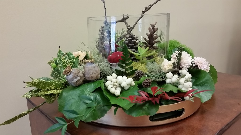 One example of a living gift is seedlings planted in a container and blended with berries, seedpods and cut flowers make an extraordinary hostess gift.