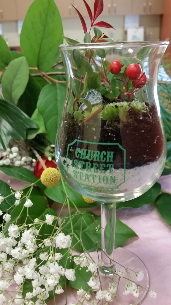Another idea involves filling a souvenir glass with soil and plants, making it a personalized living gift inspired by a special occasion.