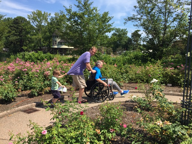 Eric Wirt, Walters' son-in-law with his grandchild in the Rose Garden.