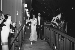 Couple making their grand exit from the Robins Tea House. Image by Andrew & Tianna Photography.
