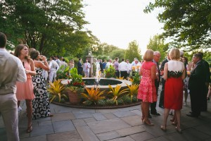 Wedding guests gather outside on the Fountain Terrace. Image by Don Mears Photography.