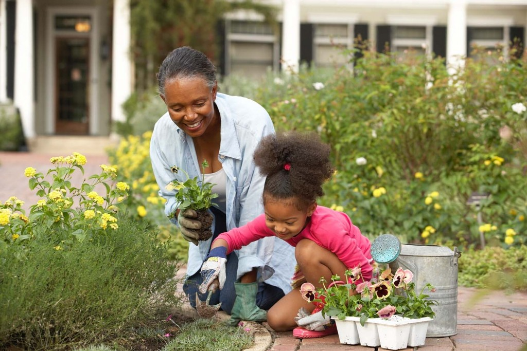 While gardening together, a child's enthusiasm can serve as therapeutic horticulture for the accompanying adult.