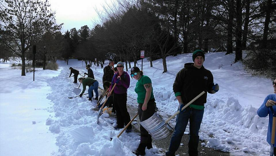 Horticulture staff at the Garden work in teams shoveling snow, making walkways safe and avoiding salt damage.