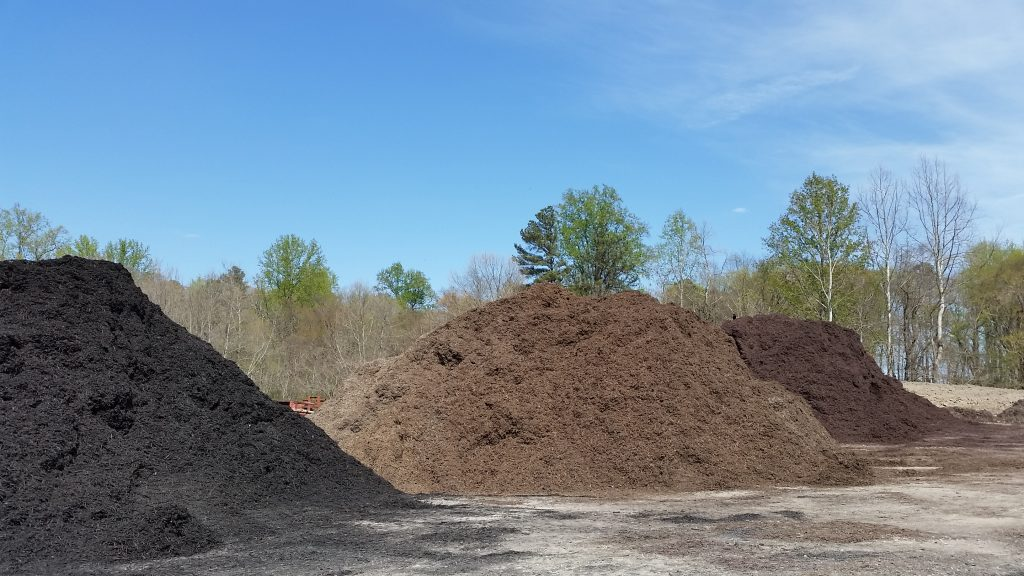 Black-dyed, natural and brown-dyed mulch appear different but their benefits are the same. Mulching is good for your plants.