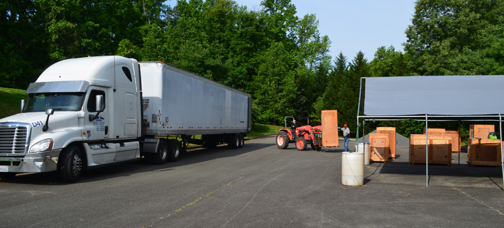 Sean Kenney's Nature Connects arriving via tractor trailer
