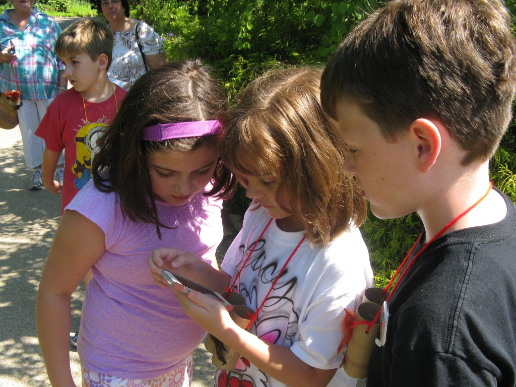 The rising 2nd-4th graders put their heads together to enter data into the Merlin Bird ID App.