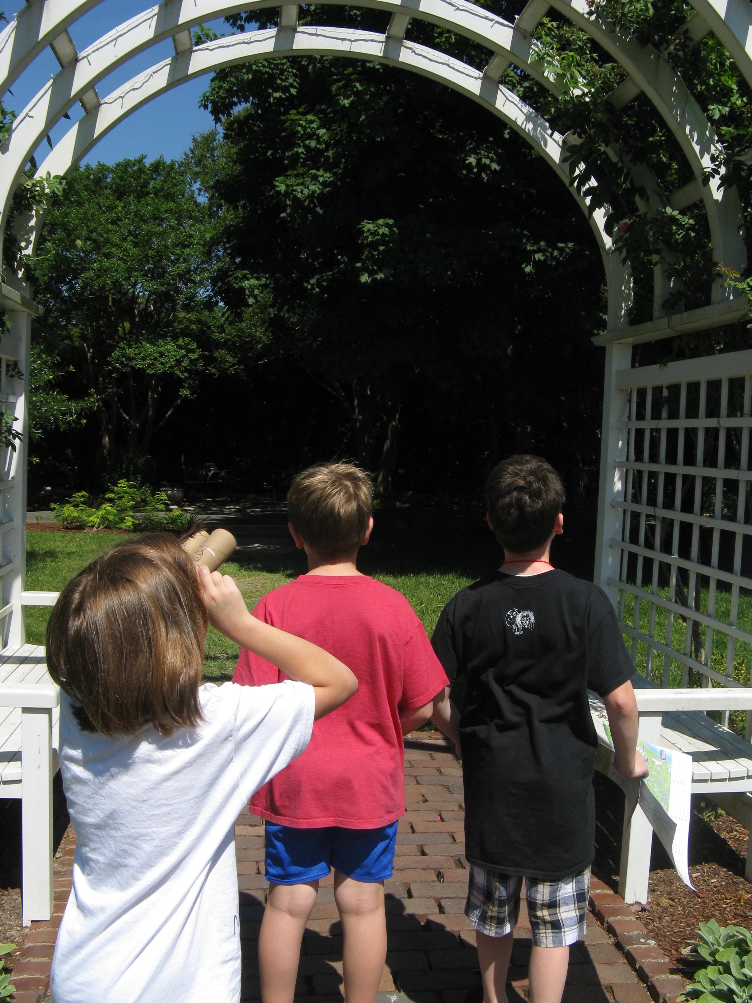 Three children watching birds at Lewis Ginter Botanical Garden